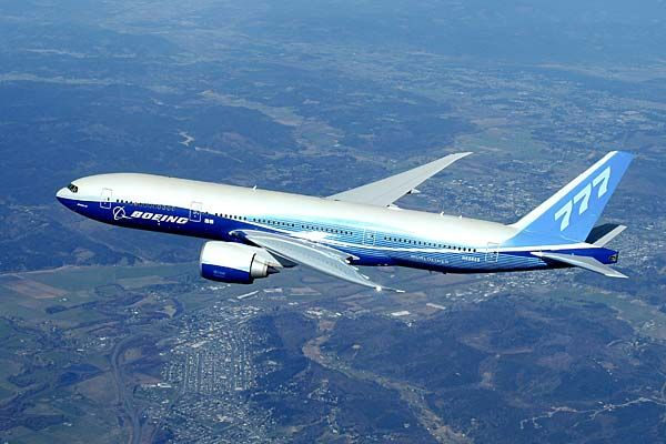 """""""Boeing 777 above clouds, crop"""" by Boeing_777_in_then-Boeing_livery_K58552.jpg: Boeing Dreamscape - derivative work: Greg A L - Boeing_777_in_then-Boeing_livery_K58552.jpg. Licensed under Creative Commons Attribution 2.0 via Wikimedia Commons - http://commons.wikimedia.org/wiki/File:Boeing_777_above_clouds,_crop.jpg#mediaviewer/File:Boeing_777_above_clouds,_crop.jpg"""